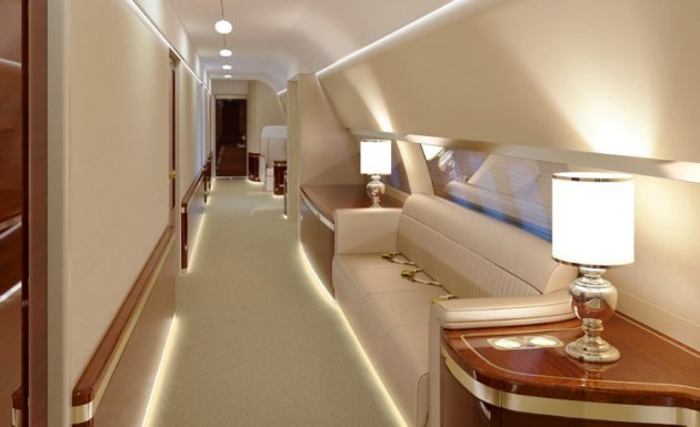 """Photos of the planes show opulent white leather chairs, gold covered trims, king size beds, hallways, kitchens and conference rooms, not to mention a gym that would put any five-star hotel to shame. The first plane, the IL-96-300 jet, will cost the Russian taxpayers 44,210,558 GBP.  The second, a IL-96-300-PU (M1), will set them back 61,231,589 GBP. The walls of each are decorated with precious paintings and although both planes aren't ready yet, they are expected to be delivered by the end of this year. But photos of the interiors leaked onto the internet have caused outrage among Russian citizens. A blogger calling himself Kungurov who first published the pictures after getting hold of them from a contact in Russia's Ministry of Defence fumed: """"Our self-proclaimed Tsar has decided to give himself a gift on his 15th anniversary of assuming the crown by whipping his slaves into paying for two luxurious IL-96 airliners for him. """"The first, an IL-96-300, will cost us taxpayers 3.75 billion rubles. """"The second, IL-96-300-PU(M1) will cost 5.2 billion."""" Russia has been spiralling into debt as it struggles to cope with western-imposed sanctions following the country's support of rebel-backed separatists in Ukraine, who many suspect are being funded and trained by Russian elite soldiers. (ends)"""