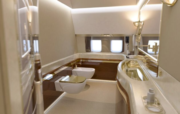 """Russian president Vladimir Putin has splashed out over 100 million GBP on two new luxury private jets, despite his country being in economic meltdown. Photos of the planes show opulent white leather chairs, gold covered trims, king size beds, hallways, kitchens and conference rooms, not to mention a gym that would put any five-star hotel to shame. The first plane, the IL-96-300 jet, will cost the Russian taxpayers 44,210,558 GBP.  The second, a IL-96-300-PU (M1), will set them back 61,231,589 GBP. The walls of each are decorated with precious paintings and although both planes aren't ready yet, they are expected to be delivered by the end of this year. But photos of the interiors leaked onto the internet have caused outrage among Russian citizens. A blogger calling himself Kungurov who first published the pictures after getting hold of them from a contact in Russia's Ministry of Defence fumed: """"Our self-proclaimed Tsar has decided to give himself a gift on his 15th anniversary of assuming the crown by whipping his slaves into paying for two luxurious IL-96 airliners for him. """"The first, an IL-96-300, will cost us taxpayers 3.75 billion rubles. """"The second, IL-96-300-PU(M1) will cost 5.2 billion."""" Russia has been spiralling into debt as it struggles to cope with western-imposed sanctions following the country's support of rebel-backed separatists in Ukraine, who many suspect are being funded and trained by Russian elite soldiers. (ends)"""